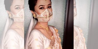 Assamese bride with mask